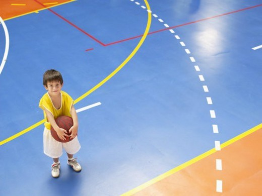 Stock Photo: 4029R-104921 Boy holding basket ball (portrait, high angle view)