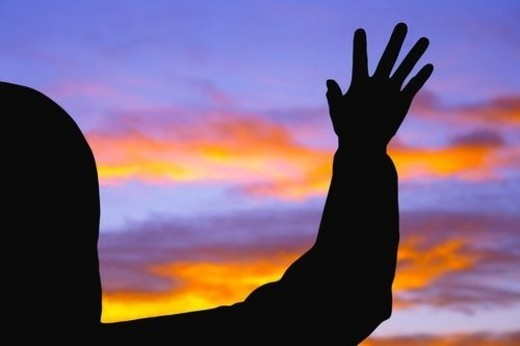Stock Photo: 4029R-104994 Silhouette of raised hand