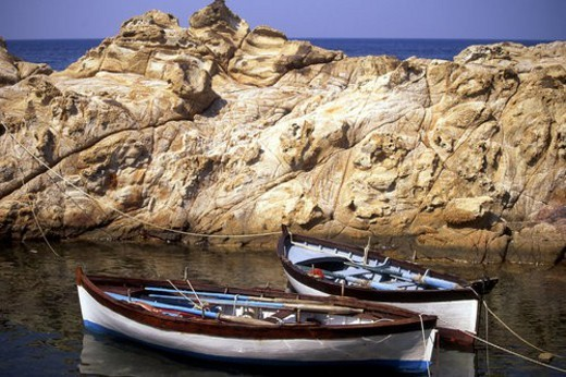 Stock Photo: 4029R-105106 Small rowboats moored in rocky inlet Elba Italy