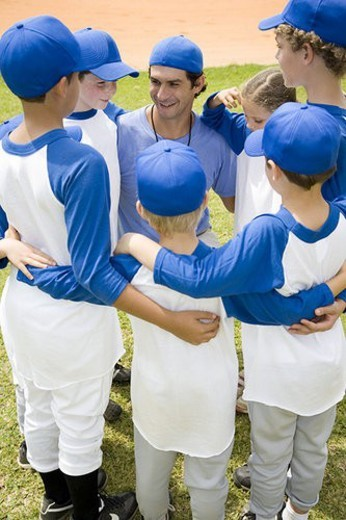 Stock Photo: 4029R-106025 Youth league baseball team in huddle with their coach