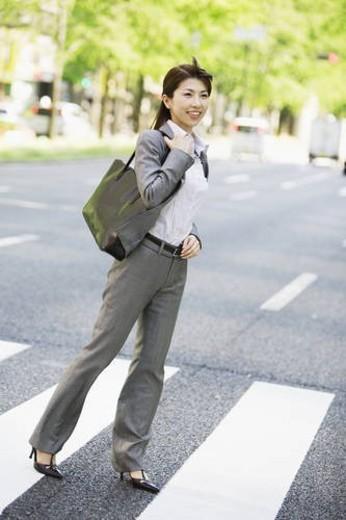 Businesswoman on zebra crossing : Stock Photo