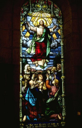 Jesus ascending into heaven on stained glass : Stock Photo