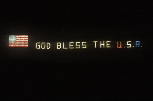 "Electric Sign with American Flag and ""God Bless The USA"" : Stock Photo"