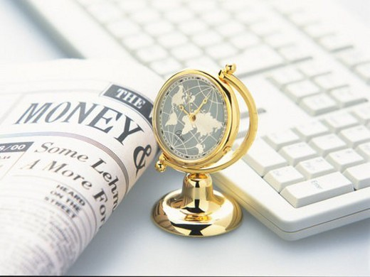 Stock Photo: 4029R-112063 Globe like clock, news paper and keyboard, High Angle View, Pin Focus