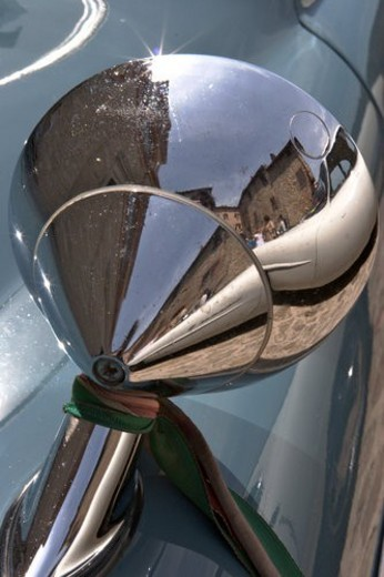 Detail of rear view wing mirror on antique car, with reflection of Italian piazza : Stock Photo
