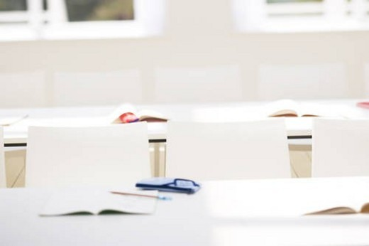 Books and stationery arranged in school classroom : Stock Photo