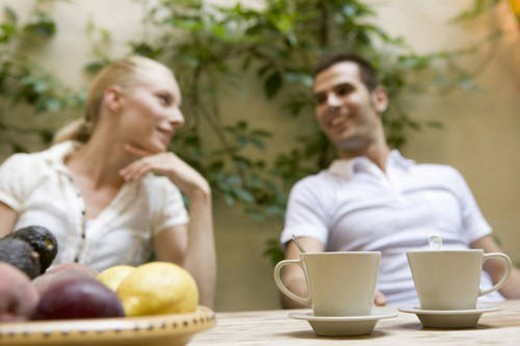 Caucasian couple relaxing, Low Angle View, Differential Focus : Stock Photo