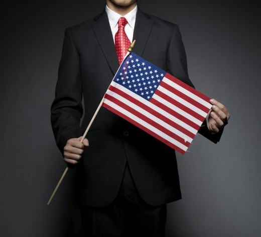 Businessman Holding American Flag : Stock Photo