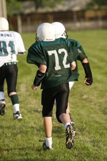 Stock Photo: 4029R-113225 tackel football. youth teens playing tackle football during practice in full equipment gear