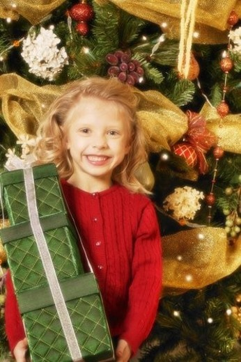 Child with Christmas present : Stock Photo
