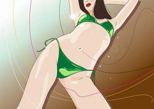 Woman dancing in a green bikini : Stock Photo