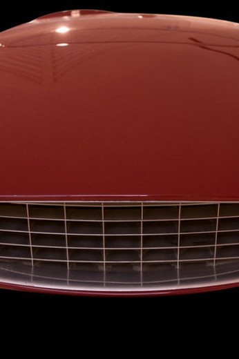 Stock Photo: 4029R-116692 Low front detail of  red Ferrari race car, view of hood and grille