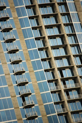 Stock Photo: 4029R-118034 Exterior of high rise building with mirrored windows and balconies.
