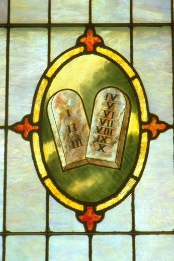 Ten commandments on stained glass at Holy Communion church : Stock Photo