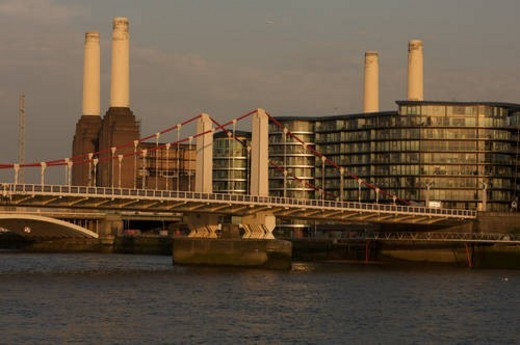 Battersea power stationin evening light with railway bridge across River Thames in foreground : Stock Photo
