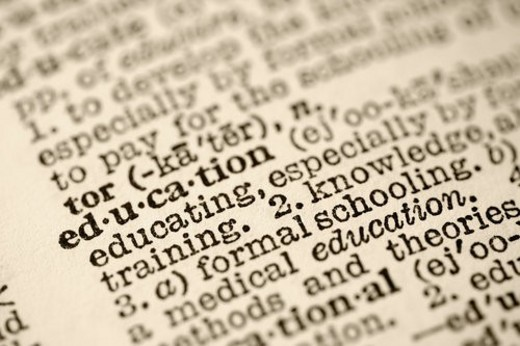 Selective focus of dictionary entry for the word education. : Stock Photo