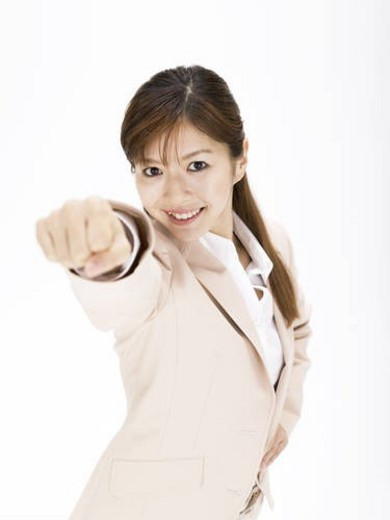 Stock Photo: 4029R-122262 Businesswoman standing in a victory pose