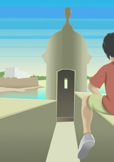 Stock Photo: 4029R-123109 Rear view of a boy sitting on wall in front of a tower