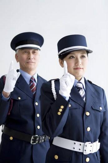 Guards raising fingers : Stock Photo