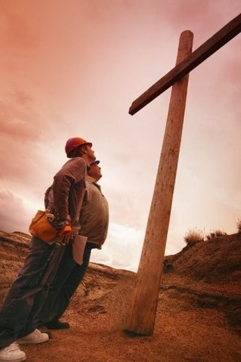 Carpenters look at the cross : Stock Photo
