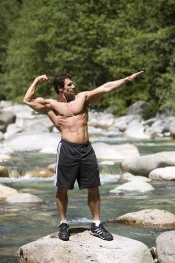 fit male exercising outdoors by a river in Vancouver British Columbia : Stock Photo