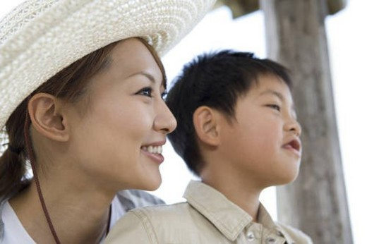 Mother and son looking away : Stock Photo