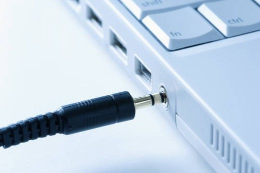 Headphone Wire Connecting to Laptop Computer. : Stock Photo