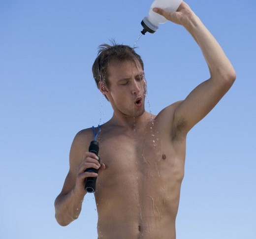 Stock Photo: 4029R-135463 A young man cooling off after exercising