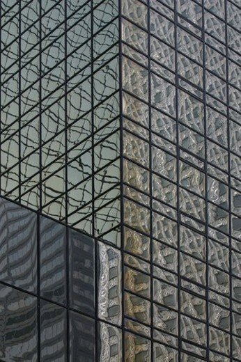 Mobil Building reflected in glass windows : Stock Photo