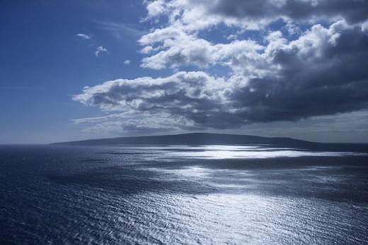 Stock Photo: 4029R-137161 Island in Pacific ocean with puffy clouds.
