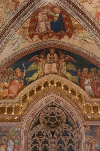 detail of apse frescoes showing coronation of the Virgin, with trefoil window, illuminated balcony : Stock Photo