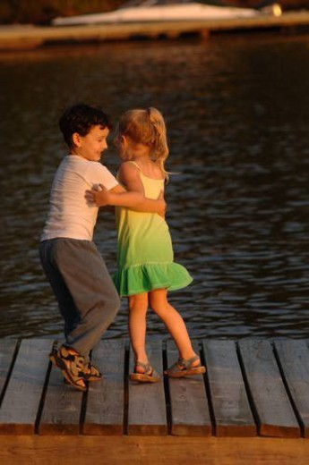 Two children dancing outdoors : Stock Photo