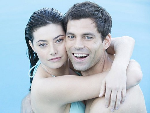 A couple embracing in a pool : Stock Photo