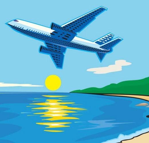 Aeroplane flying over sea : Stock Photo