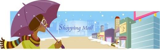 Stock Photo: 4029R-14567 young woman, shoppingmall, umbrella, snow, winter, lifestyle