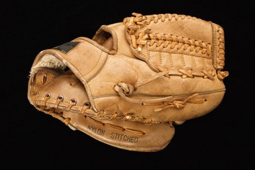 Stock Photo: 4029R-145685 Baseball glove on black.