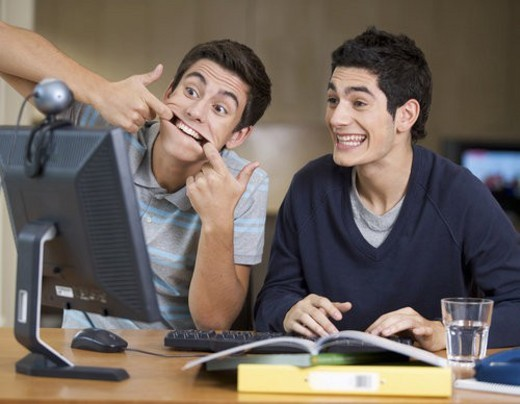 Two teenage boys studying using a computer : Stock Photo