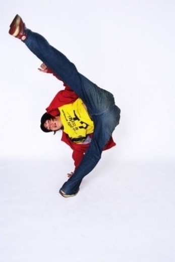 Stock Photo: 4029R-14609 Young adult man dancing, Studio, Portraint