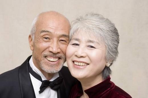 Senior couple smiling at the camera : Stock Photo