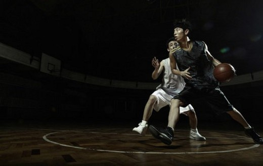 Two young men playing basketball : Stock Photo