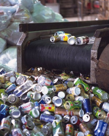Aluminum cans on factory conveyer belt , high angle view : Stock Photo