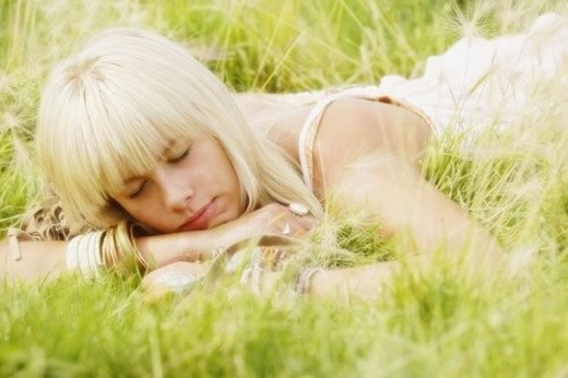 Portrait of woman lying in grass : Stock Photo