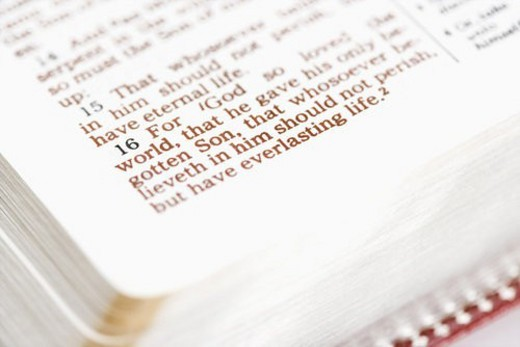 Selective focus of verses in open Holy Bible. : Stock Photo