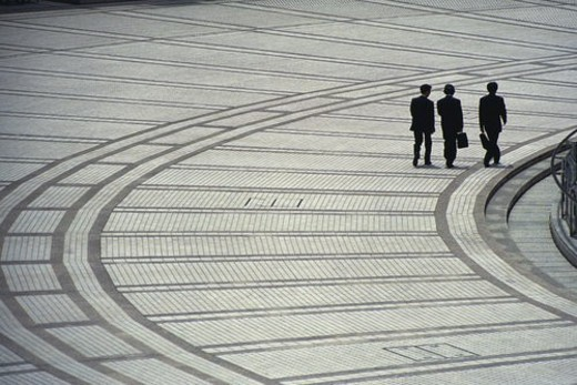Three men walking side by side, high angle view, Tokyo, Japan : Stock Photo