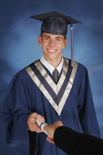 Stock Photo: 4029R-15328 Portrait of a graduate receiving scroll
