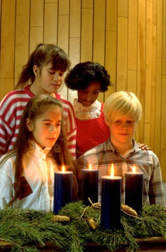 Stock Photo: 4029R-153485 Multi-ethnic friends looking at Advent candles in church