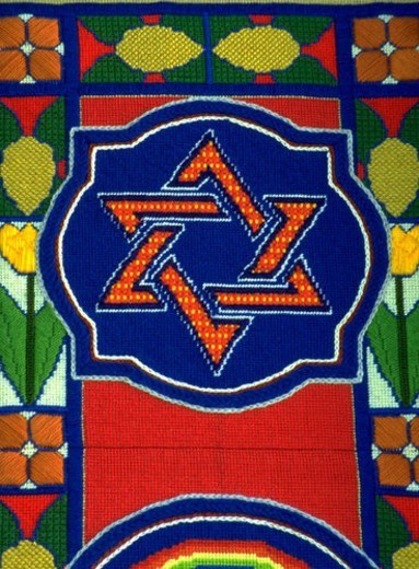 The symbol for Trinity or the Sign of David needlepoint tapestry. St Paul Minnesota USA : Stock Photo