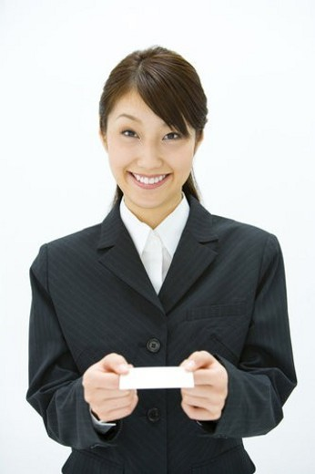 Businesswoman Exchanging Business Cards, Smiling, Three Quarter Length, Front View : Stock Photo