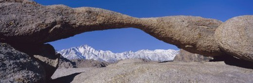 Panoramic view of Mount Whitney framed through Alabama Hills Arch in Alabama Hills : Stock Photo