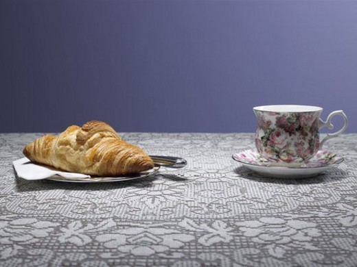 Tea cup and croissant on table : Stock Photo